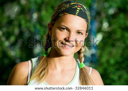 Image of smiling teen looking at camera - stock photo