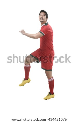 Image of soccer player header isolated over white background - stock photo
