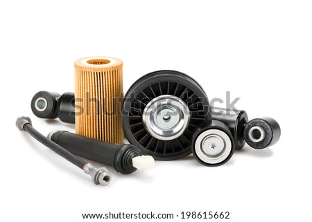 Image of some auto spare parts, isolated on white - stock photo