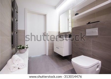 Image of spacious light bathroom with grey tiling