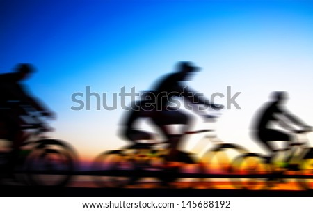 Image of sporty company friends on bicycles outdoors against sunset Silhouette  . A lot phases of motion of a single cyclist along the shoreline coast Space for inscription - stock photo