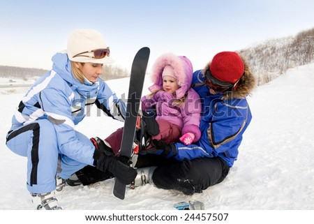 Image of sporty family spending time on winter resort during vacations - stock photo