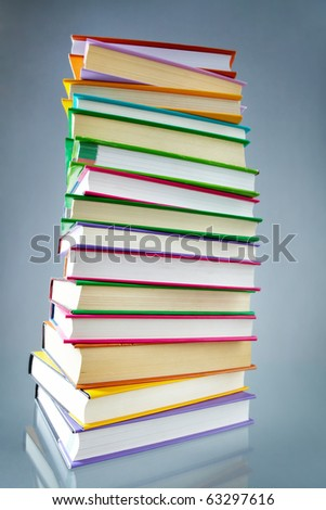 Image of stack of books with colorful covers in isolation