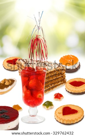 Image of strawberry cocktails and cakes closup