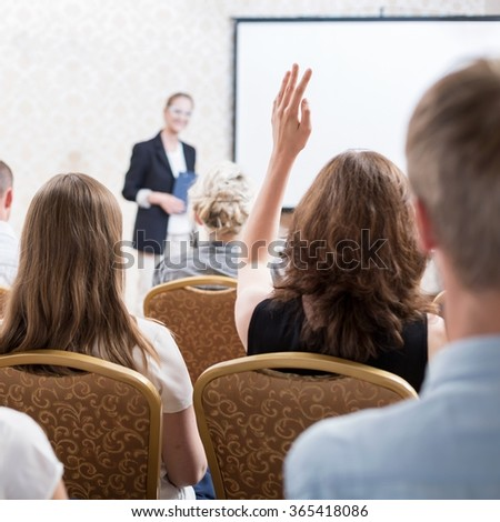 Image of students on academic conference with professor - stock photo