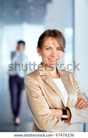 Image of successful businesswoman looking at camera - stock photo