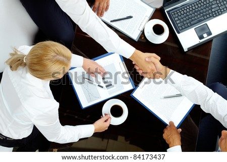 Image of successful partners handshaking after negotiations - stock photo