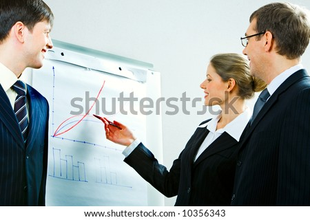 Image of successful woman explaining a right away of business-plan to her colleagues - stock photo