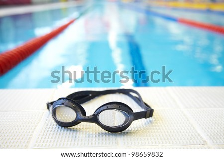 Image of swimming pool and goggles. Nobody - stock photo