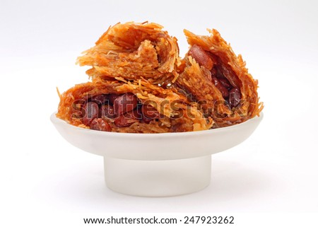 Image of tasty Oriental delicacy - baklava with peanuts - stock photo