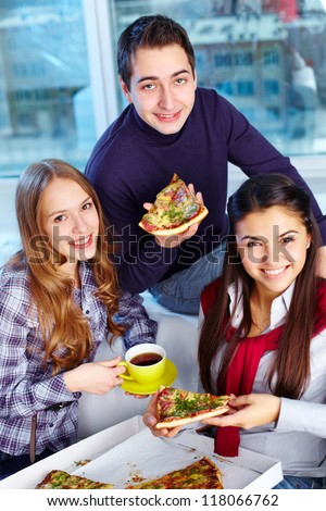 Image of teenage friends eating pizza together - stock photo