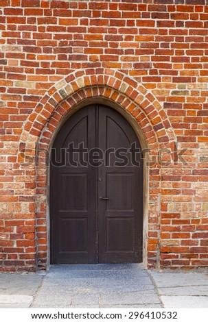 Image of the arched doorway of Saint Nicolai churh. Simrishamn, Sweden.  - stock photo