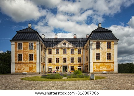 Image of the castle mansion of Christinehof, famous for its public eco park. Brosarp, Sweden.