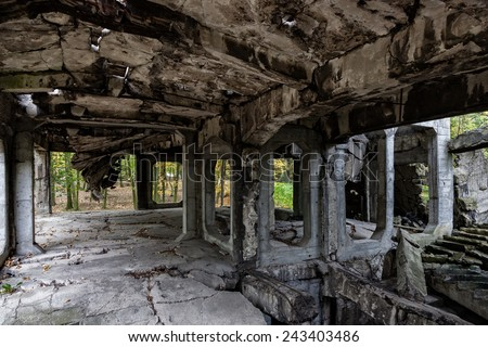 Image of the interior old destroyed military barracks after war. - stock photo