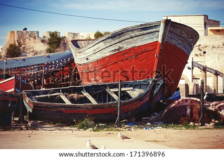 image of the old boat in the marina, toned image - stock photo