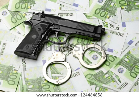 Image of the old gun and money - stock photo