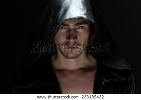 Image of the young man in hood on black background