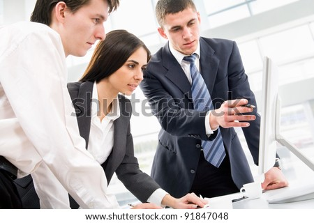 Image of three business people working at meeting - stock photo
