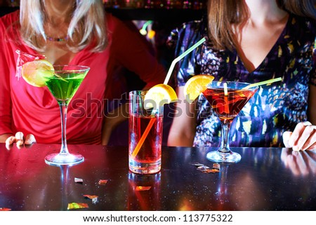Image of three cocktails on bar table - stock photo