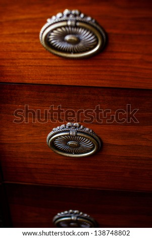 Image of three lockers on brown cupboard - stock photo