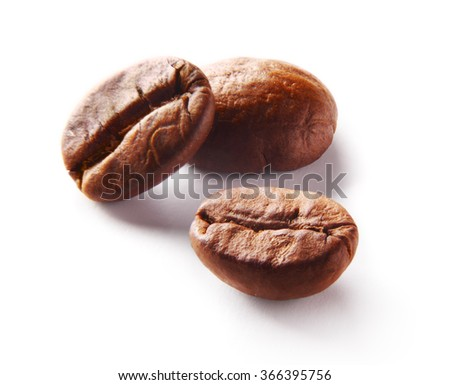 Image of three roasted coffee beans over white background - stock photo