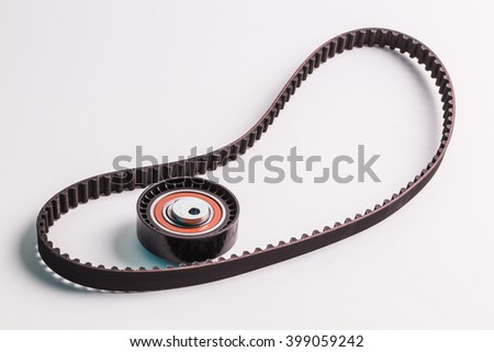 Image of timing belt with rollers on a white background - stock photo