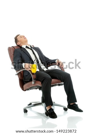Image of tired office manager resting in chair