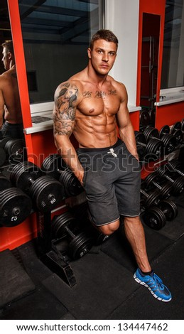 Image of topless bodybuilder who is having some rest - stock photo