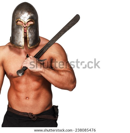 Image of topless warrior with his weapon - stock photo