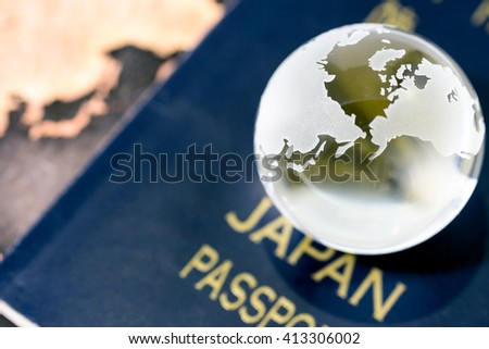 Image of traveling, with crystal globe on japanese passport
