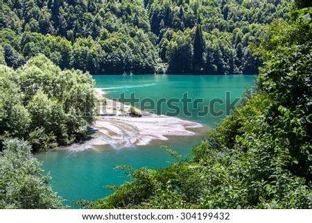 Image of turquoise lake among mountains, summer