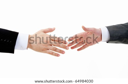 Image of two arms in isolation before business handshake - stock photo