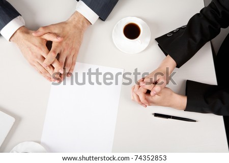 Image of two business people?s clutched hands - stock photo