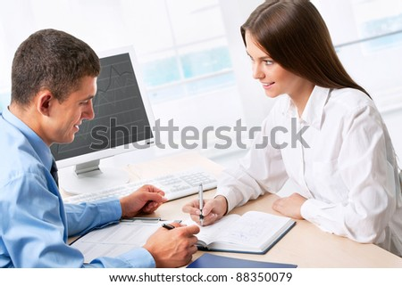 Image of two business people working at meeting - stock photo
