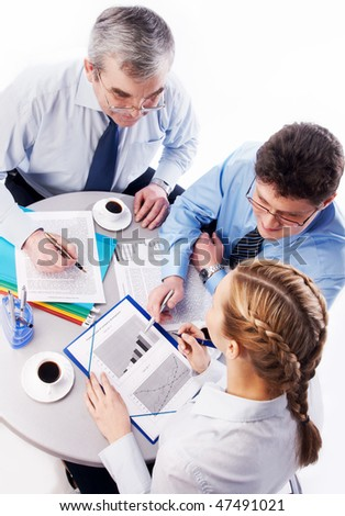 Image of two businessmen advise young colleague - stock photo