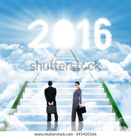 Image of two businesspeople standing on the staircase with clouds shaped numbers 2016 and future door - stock photo