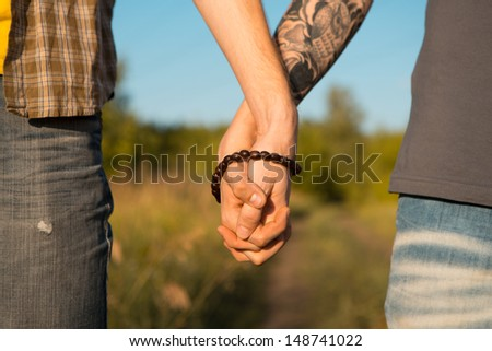 Image of two men Holding hands at gay Wedding - stock photo