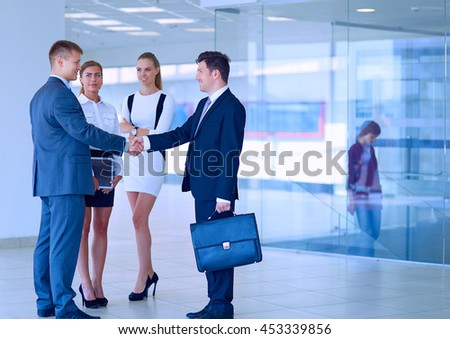 Image of two successful business men shaking hands with each other - stock photo