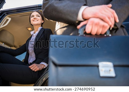 Image of two  successful confident businesspeople in suits at a meeting. - stock photo