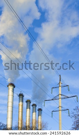 Image  of unhealthy smoke from the chimney against the blue sky - stock photo