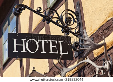 Image of unique old metal hotel sign - stock photo