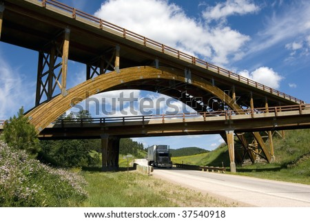 Image of unique wooden arched bridge in the Black Hills of South Dakota. - stock photo