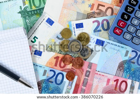Image of various denominations of banknotes and coins of euro currency