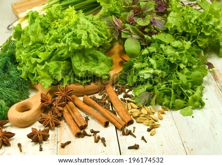 image of various herbs and spices on wooden table - stock photo