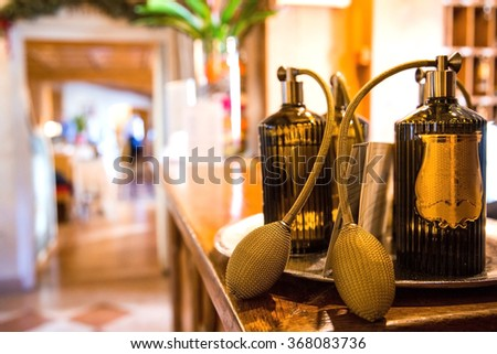 Image of victorian vintage antique classical golden perfume bottles on a wooden table.  - stock photo