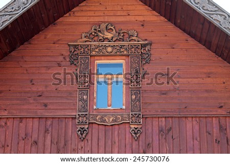 Image of vintage decorated platband on Russian house - stock photo