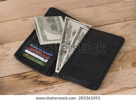 image of wallet with money and credit cards on wood backround.