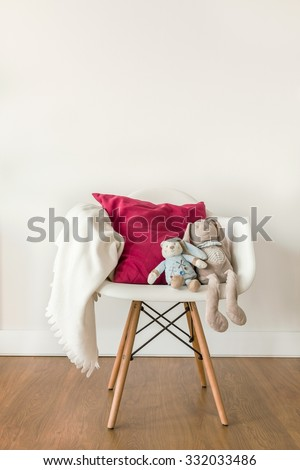 Image of white baby blanket and toy on chair - stock photo