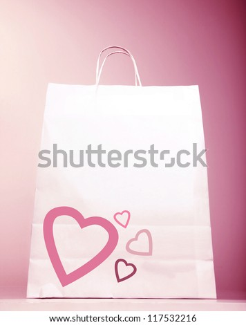Image of white shopping bag with heart isolated on pink background, Valentines day, birthday present bag, new romantic purchase, spending money, market sack, hearts decoration, love concept - stock photo