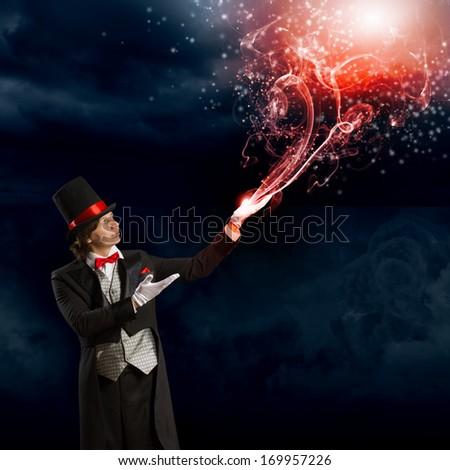 Image of wizard in red bow tie showing tricks - stock photo